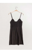 Buttoned black dress with bow