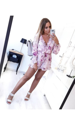 Pink romper with long sleeves and floral print