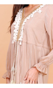 Long beige dress with pompoms
